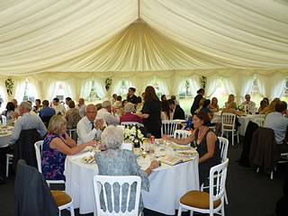 A wedding in a marquee at Lowsonford Village Hall
